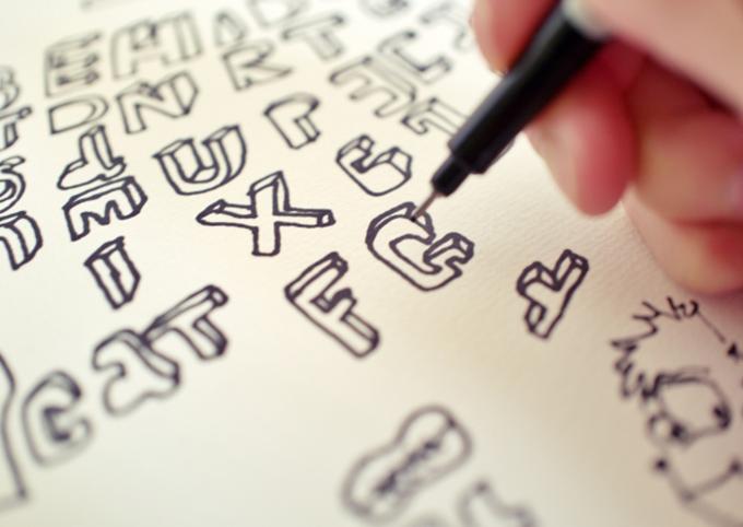 タイトルロゴをデザインしているイメージ